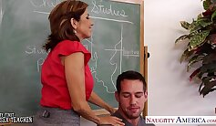 Bigtitted teacher fucks young student with strapon before class