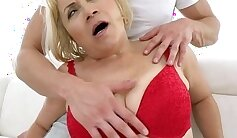 Blonde Granny receives a shaft load after anal sex