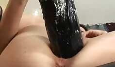 Classy euro slut licks pussy with red dildo on couch