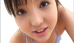 Sexy Japanese teen gently strokes and sucks a cock